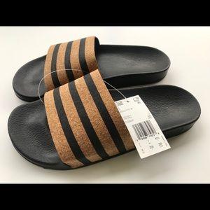 Adidas Adilette cork slides sandals.